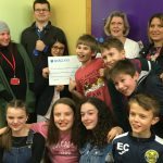Presenting a cheque to a needier youth group